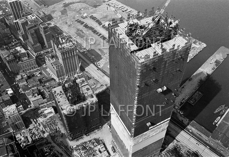 July 1970, Manhattan, New York City, New York State, USA. Aerial view of construction underway on one of the towers of the future World Trade Center in downtown Manhattan which, when completed, will be the world's highest building.