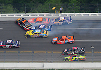 Apr 27, 2008; Talladega, AL, USA; NASCAR Sprint Cup Series drivers Martin Truex Jr (1) Tony Stewart (20) Bobby Labonte (43) Kurt Busch (2) Jamie McMurray (26) are involved in a crash during the Aarons 499 at Talladega Superspeedway. Mandatory Credit: Mark J. Rebilas-