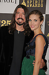 LOS ANGELES, CA. - March 05: Musician Dave Grohl (L) and Jordyn Grohl arrive at the 25th Film Independent Spirit Awards held at Nokia Theatre L.A. Live on March 5, 2010 in Los Angeles, California.