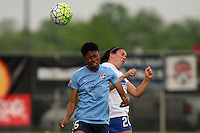 Piscataway, NJ, May 13, 2016.   Forward Maya Hayes (5) of Sky Blue FC battles defender Mollie Pathman (20) for a header.  Sky Blue FC defeated the Boston Breakers, 1-0, in a National Women's Soccer League (NWSL) match at Yurcak Field.