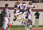 25 November 2006: East Carolina's Brandon Fractious (l) celebrates his fourth quarter touchdown run with teammates in the endzone. The East Carolina University Pirates defeated the North Carolina State University Wolfpack 21-16 at Carter Finley Stadium in Raleigh, North Carolina in an NCAA Division I College Football game.