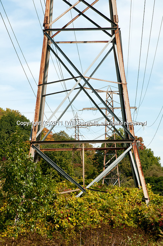 Hydro Towers through a field in Autumn