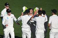 Trent Boult celebrates the wicket of Cook with BJ Watling (centre)<br /> New Zealand Blackcaps v England. 1st day/night test match. Eden Park, Auckland, New Zealand. Day 4, Sunday 25 March 2018. &copy; Copyright Photo: Andrew Cornaga / www.Photosport.nz