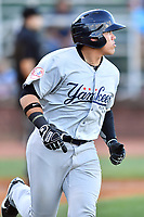 Pulaski Yankees third baseman Andres Chaparro (18) runs to first base during a game against the Elizabethton Twins at Joe O'Brien Field on June 27, 2016 in Elizabethton, Tennessee. The Yankees defeated the Twins 6-4. (Tony Farlow/Four Seam Images)