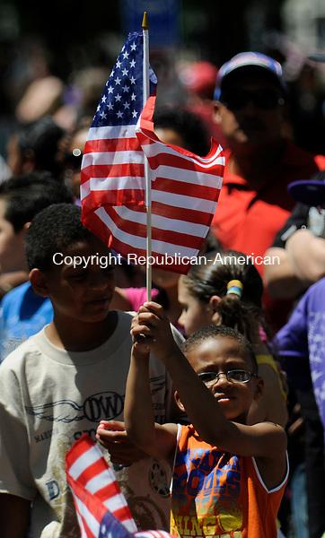 WATERBURY, CT-30 MAY 2010-053010IP09- Caleb Trotman, 6, of Waterbury, holds the American flag during the Memorial Day parade in Waterbury on Sunday.                                                                                                                                                                                                                                                                                                                                                                                                                                                                                                                                                                                                                                                                                                                                                                                                                                                                                                                                                                                                                                                                                                                                                                    <br /> Irena Pastorello Republican-American