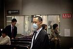 Tokyo - 6th ofNovember 2009 - Salaryman going back home at Naka-meguro  train station.