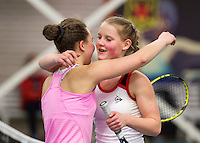 March 8, 2015, Netherlands, Rotterdam, TC Victoria, NOJK, Suzan Lamens wins girls 16 years and is congratulated by runner up Donarosa Gouvernante (L)<br /> Photo: Tennisimages/Henk Koster
