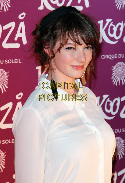 "Dakota Blue Richards.VIP Night for Cirque du Soleil's new production, ""Kooza"" at the Royal Albert Hall, London, England..January 8th 2013.half length white shirt dangling earrings.CAP/ROS.©Steve Ross/Capital Pictures."