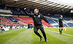 Neil Lennon running up to the corner flag as he celebrates Hibs' equaliser