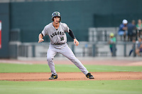 First baseman Jacob Gonzalez (18) of the Augusta GreenJackets takes a lead off first base in a game against the Columbia Fireflies on Thursday, July 11, 2019 at Segra Park in Columbia, South Carolina. Columbia won, 5-2. (Tom Priddy/Four Seam Images)