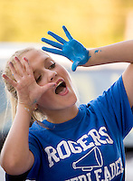 NWA Democrat-Gazette/JASON IVESTER <br /> Rogers High freshman cheerleader Grace Hescott (cq) takes a break while helping paint spirit sheet signs on Wednesday, Aug. 12, 2015, outside the school's football stadium. Members of the cheer squad painted the signs to hang inside the stadium for the upcoming season.