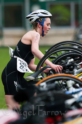 02 MAY 2010 - CALNE, GBR - Heather Sellars (Leeds Met Carnegie) unracks her bike as she prepares to go out onto the bike course at the BUCS Sprint Triathlon Championships (PHOTO (C) NIGEL FARROW)