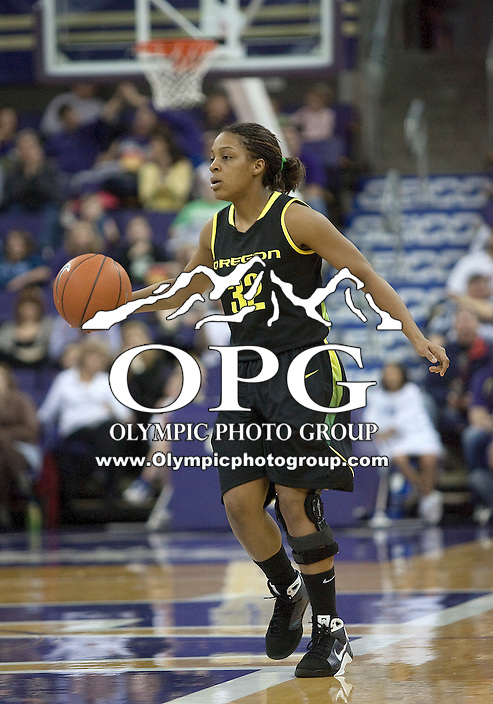 7 March 2010:   Oregon guard #32 Nia Jackson brings the ball down court against Washington. Washington won over Oregon 62-53 at the Bank of America Arena in Seattle, WA.