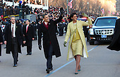 President Barack Obama and First Lady Michelle Obama walk down Pennsylvania Avenue with daughters Sasha and Malia enroute to the White House, Tuesday,  Jan. 20, 2009.  ( (Doug Mills/ The New York Times)