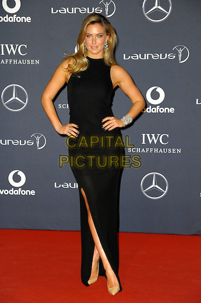 Bar Refaeli.Arrivals at the Laureus 2012 World Sports Awards held at the Queen Elizabeth II Centre, London, England..February 6th, 2012.full length black dress sleeveless hands on hips split split.CAP/CAS.©Bob Cass/Capital Pictures.