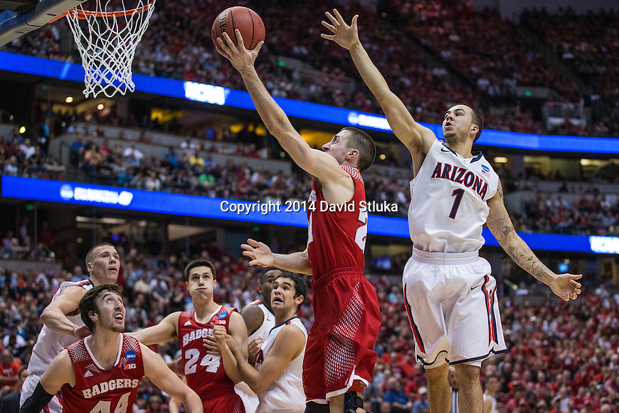 Wisconsin Badgers guard Josh Gasser (21) shoots the ball during the Western Regional Final NCAA college basketball tournament game against the Arizona Wildcats Saturday, March 29, 2014 in Anaheim, California. The Badgers won 64-63 (OT). (Photo by David Stluka)