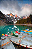 As the first light hits the high peaks in Banff National Park, the quiet waters of Moraine Lake await kayakers on another fun summer day. The waters here are clear, cold, and beautiful, and mornings can be spectacular.
