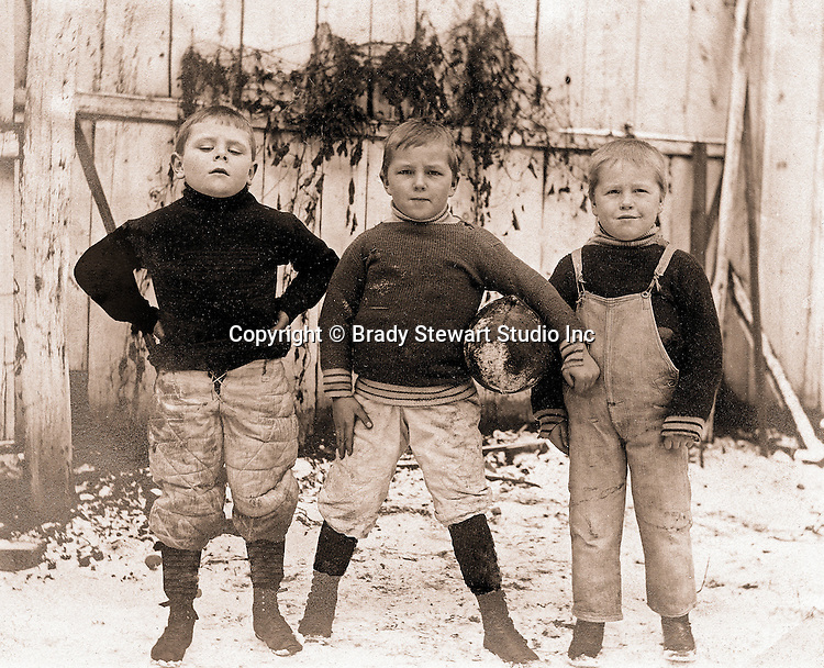 East McKeesport PA:  Three boys from Brady Stewart's neighborhood getting ready for a football game - 1902