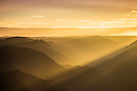 The light beams of sunrise at Waimea Canyon on the island of Kauai, Hawaii.  Waimea Canyon is known as the Grand Canyon of the Pacific and truly is grand.