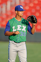 Center fielder Alfredo Escalera-Maldonado (26) of the Lexington Legends warms up before a game against the Greenville Drive on Friday, August 29, 2014, at Fluor Field at the West End in Greenville, South Carolina. Greenville won, 6-1. (Tom Priddy/Four Seam Images)