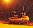 Boat on shore, Båt på land. A snowy weather and a single light made a special mood.