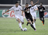 D.C. United forward Charlie Davies (9) shields the ball against Vancouver Whitecaps FC defender Michael Boxall (2). D.C. United defeated The Vancouver Whitecaps FC 4-0 at RFK Stadium, Saturday August 13 , 2011.