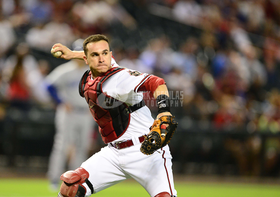 Sept. 11, 2012; Phoenix, AZ, USA: Arizona Diamondbacks catcher Miguel Montero throws to first base for an out in the first inning against the Los Angeles Dodgers at Chase Field. Mandatory Credit: Mark J. Rebilas-
