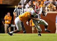 KNOXVILLE, TN - OCTOBER 5: Henry To'o To'o #11 of the Tennessee Volunteers attempts to tackle Tyler Simmons #87 of the Georgia Bulldogs during a game between University of Georgia Bulldogs and University of Tennessee Volunteers at Neyland Stadium on October 5, 2019 in Knoxville, Tennessee.