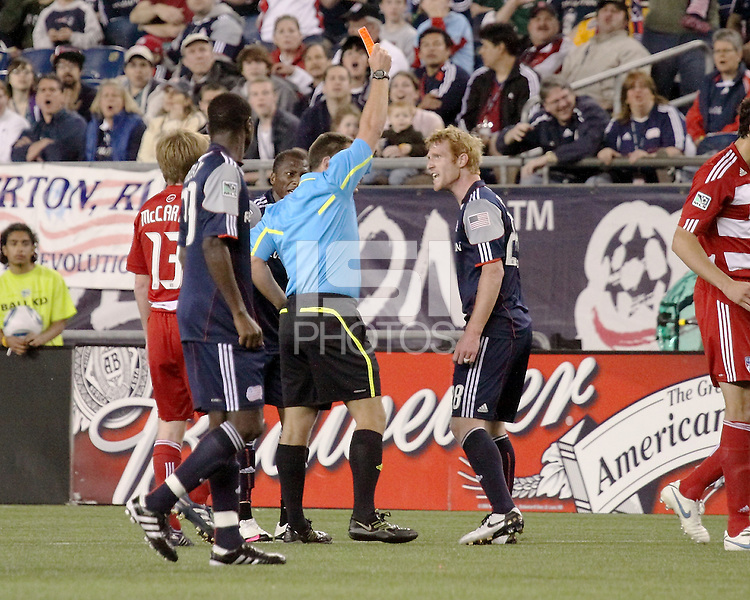 The referee, Jeff Gontarek issues the first of two red cards against the Revolution early in the second half as New England Revolution midfielder Pat Phelan (28) and New England Revolution midfielder Sainey Nyassi (14) dispute the call.   The New England Revolution drew FC Dallas 1-1, at Gillette Stadium on May 1, 2010