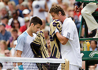 25-6-08, England, Wimbledon, Tennis, Djokovic and Safin during changeover