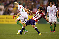 Chivas USA midfielder Sal Zizzo battles with Chivas de Guadalajara midfielder Adolfo 'Bofo' Bautista. Chivas USA forwardLos CD Chivas  vs  at Petco Park stadium in San Diego, California on Tuesday September 14, 2010.
