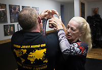 """Susa Johnson of McCalister, Okla. (right) performs a silat maneuver on Matthew Campbell of Wilburton, Okla. (left), Saturday, June 20, 2020 at Integrated Combat Systems NWA in Fayetteville. Instructors provided a four hour silat seminar for combat enthusiasts and people interested in self-defense. Silat is an Indonesian form of martial arts involving empty hand combat, grappling and bladed fighting. """"Unlike other martial arts, everything is trained concurrently. You apply the same concepts with empty hands as with weapons. It's a more streamlined process of learning how to fight and defend yourself,"""" said Diem Ngu, owner and instructor. Check out nwaonline.com/200621Daily/ for today's photo gallery. <br /> (NWA Democrat-Gazette/Charlie Kaijo)"""