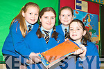 MAKING A DIFFERENCE: Pupils from Scoil an Chroi Naofa have been shortlisted for this years Our World Aid Award in Dublin on February 10th. From l-r: Amy O'Mahony, Miriam Gurrie, Siobha?n O'Connor and Jade Smullen.