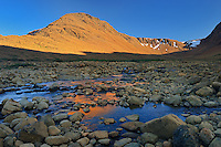 Last light on the Tablelands (Earth's mantle)  made up of Peridotite which is high in iron<br />Gros Morne National Park<br />Newfoundland &amp; Labrador<br />Canada