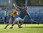 Conor Mc Grath of Clare in action against Anthony Nash of Cork during their Munster Hurling League game at Cusack Park. Photograph by John Kelly.
