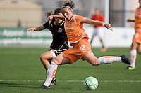 Megan Schnur (12) kicks the ball against Tina DiMartino. FC Gold Pride defeated Sky Blue FC 1-0 at Buck Shaw Stadium in Santa Clara, California on May 3, 2009.