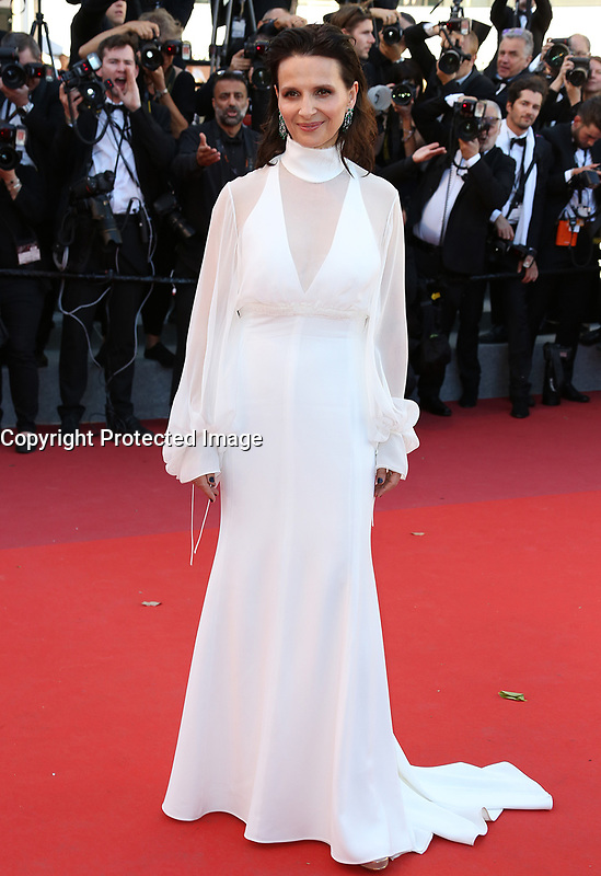 JULIETTE BENOCHE<br /> Okja Red Carpet Arrivals - The 70th Annual Cannes Film Festival<br /> CANNES, FRANCE - MAY 19: attends the 'Okja' screening during the 70th annual Cannes Film Festival at Palais des Festivals on May 19, 2017 in Cannes