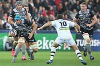 Justin Tipuric of Ospreys is marked by Camille Lopez of Clermontd during the Champions Cup Round 1 match between Ospreys and Clermont at The Liberty Stadium, Swansea, Wales, UK. Sunday 15 October 2017