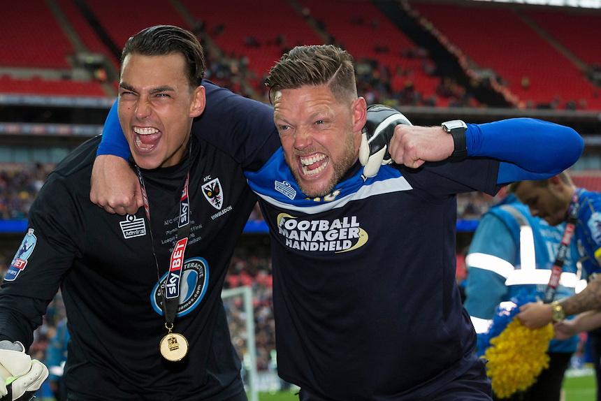 AFC Wimbledon's Kelle Roos (left) celebrates with goalkeeping coach Ashley Bayes (right)<br /> <br /> Photographer Craig Mercer/CameraSport<br /> <br /> Football - The Football League Sky Bet League Two Play-Off Final - AFC Wimbledon v Plymouth Argyle - Monday 30 May 2016 - Wembley Stadium - London<br /> <br /> World Copyright &copy; 2016 CameraSport. All rights reserved. 43 Linden Ave. Countesthorpe. Leicester. England. LE8 5PG - Tel: +44 (0) 116 277 4147 - admin@camerasport.com - www.camerasport.com