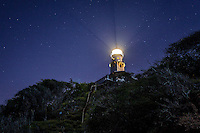 Diamond Head Lighthouse against starry night sky, East Honolulu, O'ahu.