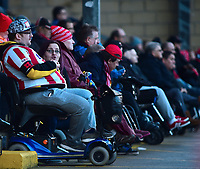 Lincoln City fans watch their team in action<br /> <br /> Photographer Andrew Vaughan/CameraSport<br /> <br /> Emirates FA Cup First Round - Lincoln City v Northampton Town - Saturday 10th November 2018 - Sincil Bank - Lincoln<br />  <br /> World Copyright © 2018 CameraSport. All rights reserved. 43 Linden Ave. Countesthorpe. Leicester. England. LE8 5PG - Tel: +44 (0) 116 277 4147 - admin@camerasport.com - www.camerasport.com