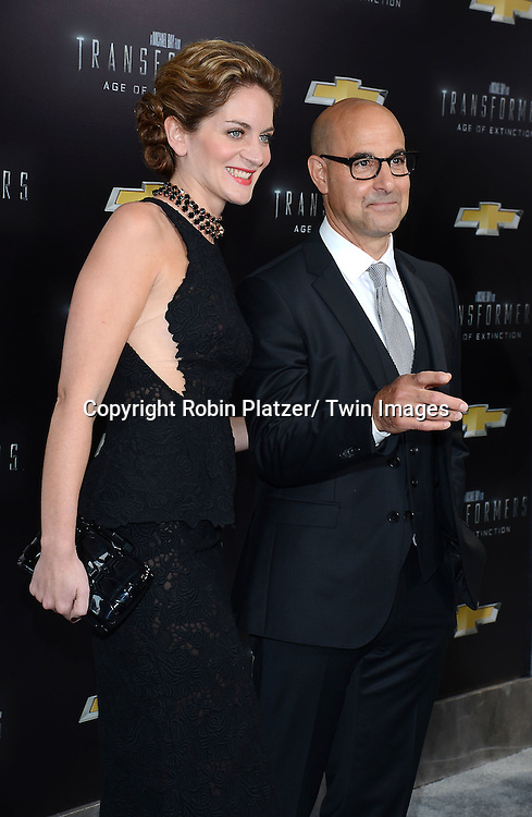 "Felicity and Stanley Tucci attends the US Premiere of ""Transformers: Age of Extinction"" on June 25, 2014 at The Ziegfeld Theatre in New York City, New York, USA."