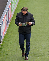 Wycombe Wanderers Manager Gareth Ainsworth reads the matchday programme ahead of the Sky Bet League 2 match between Barnet and Wycombe Wanderers at The Hive, London, England on 17 April 2017. Photo by Andy Rowland.