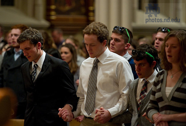 Oct. 28, 2010: Students pray in the Basilica of the Sacred Heart at the University of Notre Dame for a Mass of remembrance for Declan Sullivan, a junior who was killed Oct. 27 when a scissor lift in which he had been videotaping football practice toppled over...Photo by Matt Cashore/University of Notre Dame
