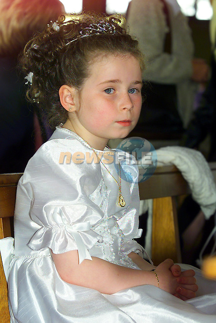 Christina Reynolds making her first communion in the Holy Family church..Pic Fran Caffrey Newsfile