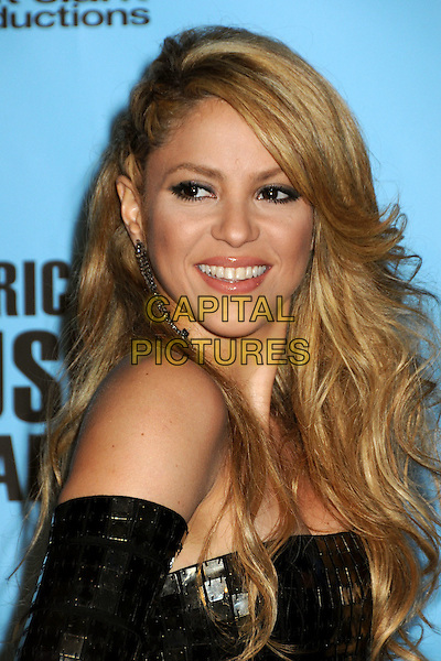 SHAKIRA (Shakira Isabel Mebarak Ripoll).At the 2009 American Music Awards - Press Room held at the Nokia Theatre L.A. Live, Los Angeles, California, USA, .22nd November 2009..AMA AMAs portrait headshot  dangly earring strapless black smiling squares tiles tiled sequin sequined  hair plaits plaited braids braided.CAP/ADM/BP.©Byron Purvis/AdMedia/Capital Pictures.