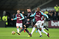 Olivier Giroud of Arsenal battles Angelo Ogbonna of West Ham United during the Premier League match between West Ham United and Arsenal at the Olympic Park, London, England on 13 December 2017. Photo by Andy Rowland.