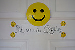 """Aug 10, 2008 -- COLORADO CITY: A smiley face on the front door of the Jessop home in Colorado City, AZ. The Jessops are polygamists and members of the FLDS. Colorado City and neighboring town of Hildale, UT, are home to the Fundamentalist Church of Jesus Christ of Latter Day Saints (FLDS) which split from the mainstream Church of Jesus Christ of Latter Day Saints (Mormons) after the Mormons banned plural marriage (polygamy) in 1890 so that Utah could gain statehood into the United States. The FLDS Prophet (leader), Warren Jeffs, has been convicted in Utah of """"rape as an accomplice"""" for arranging the marriage of teenage girl to her cousin and is currently on trial for similar, those less serious, charges in Arizona. After Texas child protection authorities raided the Yearning for Zion Ranch, (the FLDS compound in Eldorado, TX) many members of the FLDS community in Colorado City/Hildale fear either Arizona or Utah authorities could raid their homes in the same way. Older members of the community still remember the Short Creek Raid of 1953 when Arizona authorities using National Guard troops, raided the community, arresting the men and placing women and children in """"protective"""" custody. After two years in foster care, the women and children returned to their homes. After the raid, the FLDS Church eliminated any connection to the """"Short Creek raid"""" by renaming their town Colorado City in Arizona and Hildale in Utah.    Photo by Jack Kurtz / ZUMA Press"""
