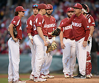 NWA Democrat-Gazette/ANDY SHUPE<br /> Arkansas coach Dave Van Horn hands the ball Friday, May 10, 2019, to reliever Kevin Kopps while making a pitching change during the fourth inning against LSU at Baum-Walker Stadium in Fayetteville. Visit nwadg.com/photos to see more photographs from the game.