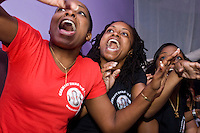 Trinidad and Tobago fans (L-R) Tamara, Dele, and Josanne cheer on their team during their World Cup match against England on June 15, 2006 at Reign, a New York City nightclub.<br /> <br /> The World Cup, held every four years in different locales, is the world's pre-eminent sports tournament in the world's most popular sport, soccer (or football, as most of the world calls it).  Qualification for the World Cup is open to any country with a national team accredited by FIFA, world soccer's governing body. The first World Cup, organized by FIFA in response to the popularity of the first Olympic Games' soccer tournaments, was held in 1930 in Uruguay and was participated in by 13 nations.    <br /> <br /> As of 2010 there are 208 such teams.  The final field of the World Cup is narrowed down to 32 national teams in the three years preceding the tournament, with each region of the world allotted a specific number of spots.  <br /> <br /> The World Cup is the most widely regularly watched event in the world, with soccer teams being a source of national pride.  In most nations, the whole country is at a standstill when their team is playing in the tournament, everyone's eyes glued to their televisions or their ears to the radio, to see if their team will prevail.  While the United States in general is a conspicuous exception to the grip of World Cup fever there is one city that is a rather large exception to that rule.  In New York City, the most diverse city in a nation of immigrants, the melting pot that is America is on full display as fans of all nations gather in all possible venues to watch their teams and celebrate where they have come from.